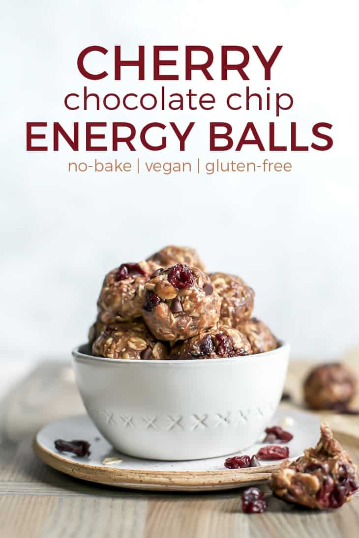 dried cherry chocolate chip energy balls in white bowl on pottery plate