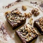 square walnut brownies on parchment paper