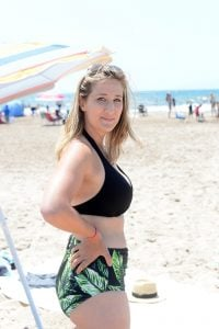 On the beach in black halter top and albion fit laguna high waist bottoms