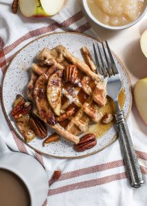 plate of apple cinnamon waffles with pecans