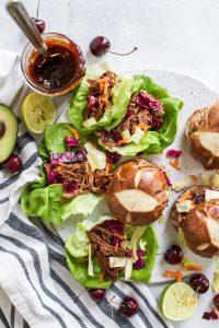 Cherry Chipotle BBQ Pulled Pork lettuce wraps and pretzel sliders