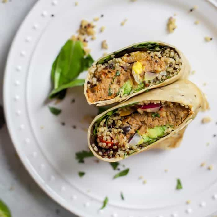 cut open face up pollock fish burger wrap with quinoa and avocado