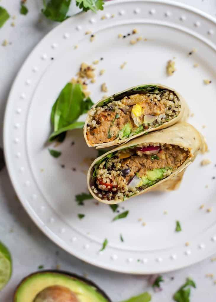 cut open face up pollock fish burger wrap with quinoa and avocado