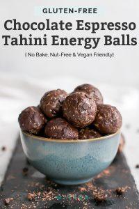 chocolate tahini energy balls in blue bowl on black slate