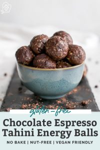 bowl of chocolate tahini energy balls on black slate