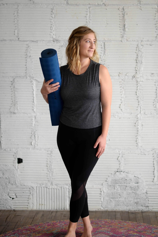holding yoga mat