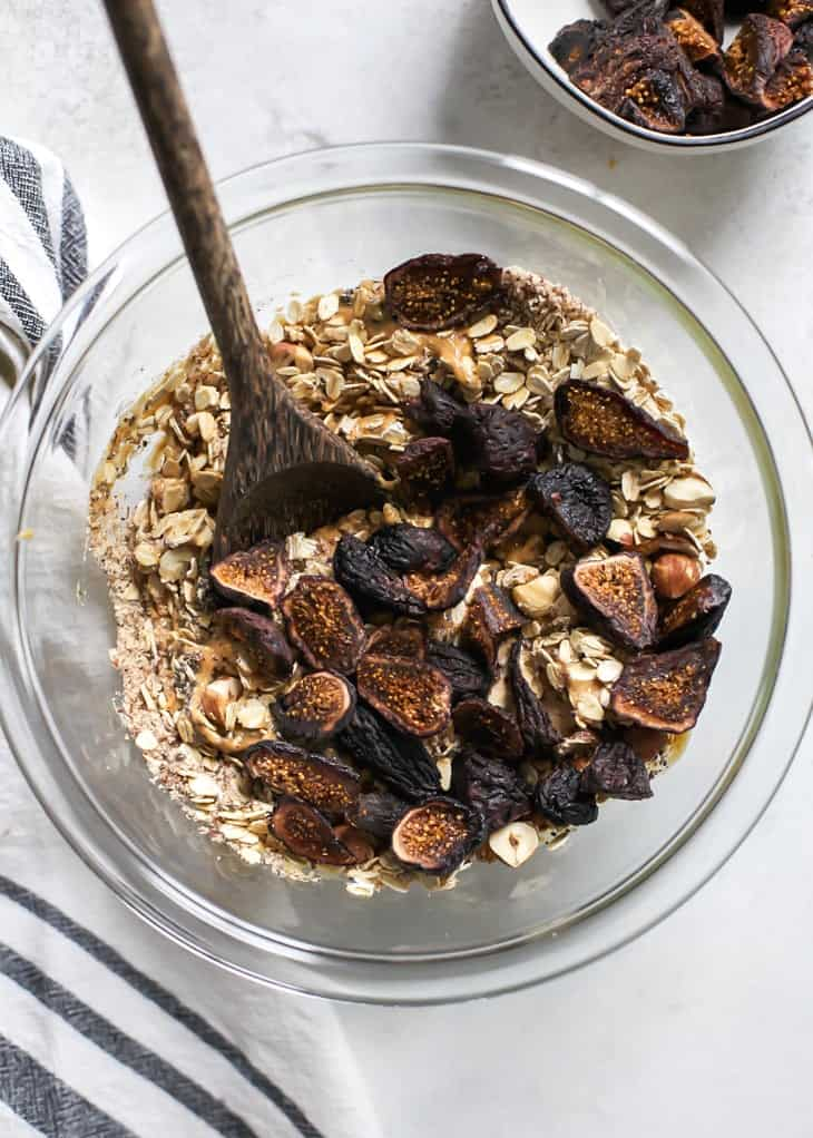 mixing bowl with dried figs for hazelnut fig granola bars