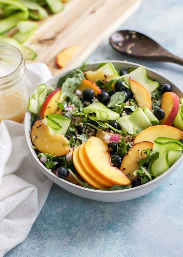 bowl of salad greens for peach salad with zucchini ribbons