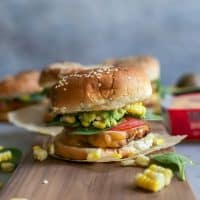 cheddar turkey burger with sesame seed bun on board