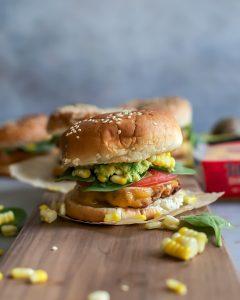 cheddar turkey burger with sesame seed bun on board