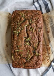 loaf of banana zucchini bread on parchment paper