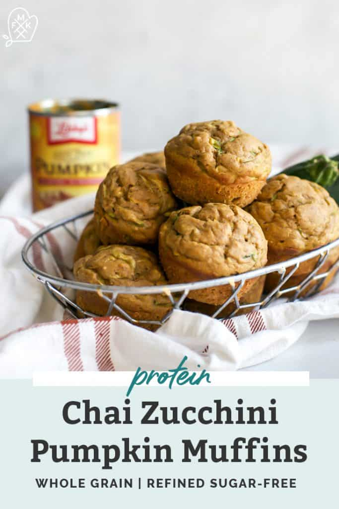 chai zucchini pumpkin muffins piled into metal, wire bowl with pumpkin puree in background
