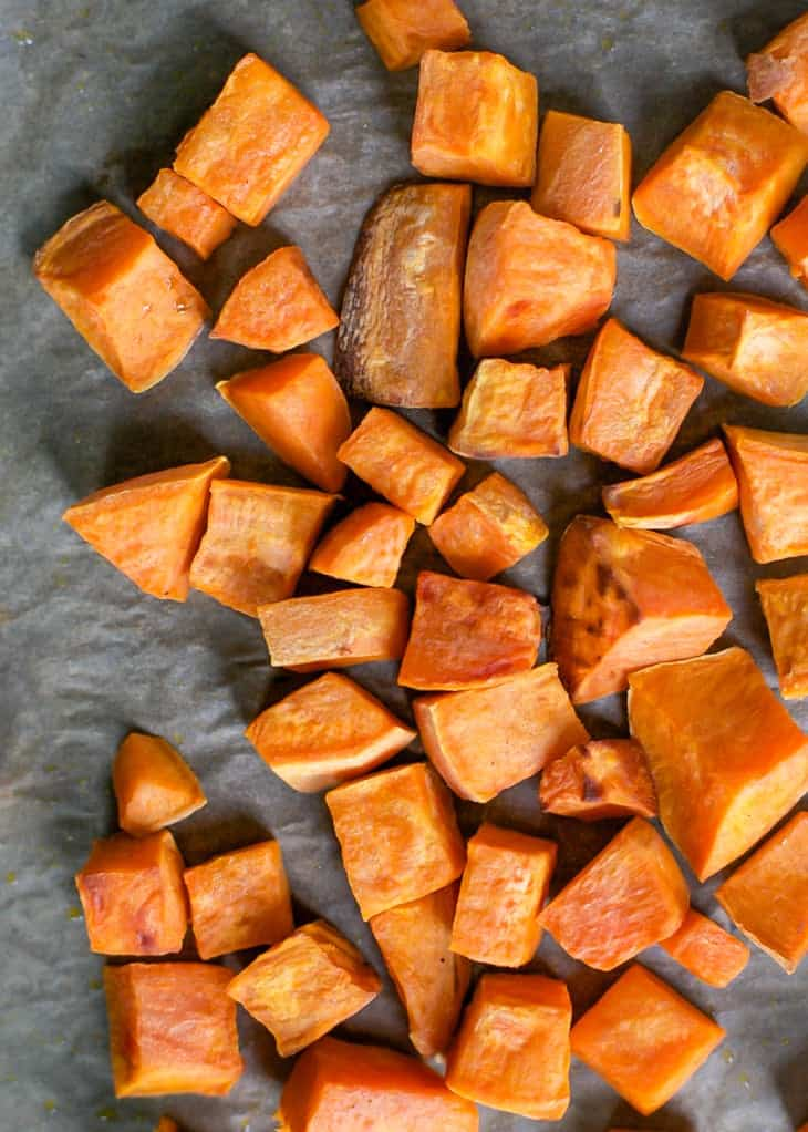 roasted cubed sweet potatoes on pan