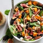 bowl of blackberry fig salad with roasted sweet potatoes and tahini dressing