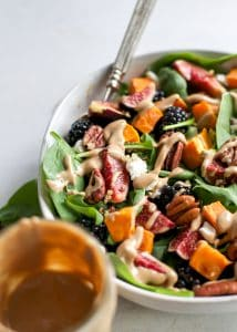 up close shot of a fig salad with tahini dressing in jar