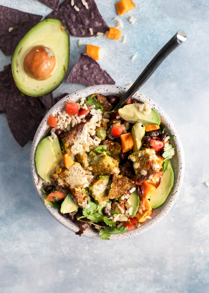 burrito bowl with avocado, sweet potato, black beans, and veggie burger