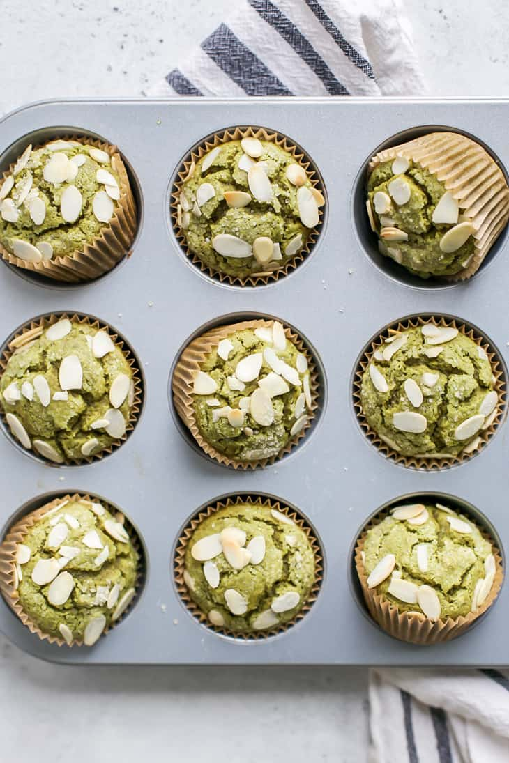 almond matcha muffins in muffin pan