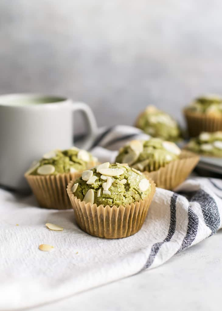 matcha muffins on tea towel with mug