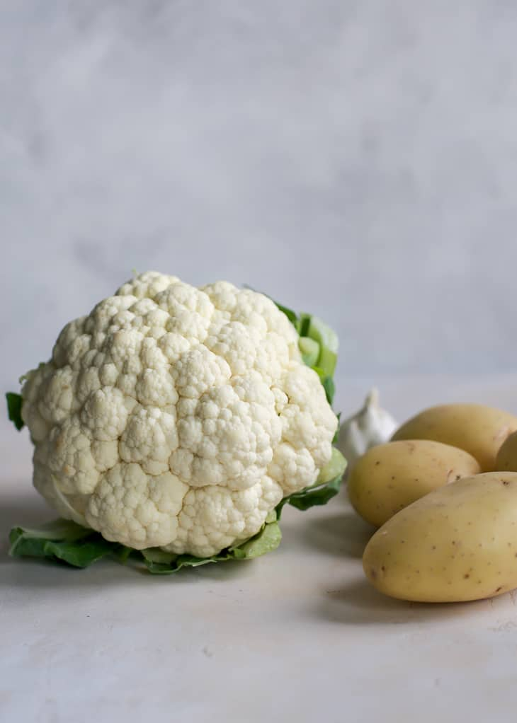 head of cauliflower and potatoes