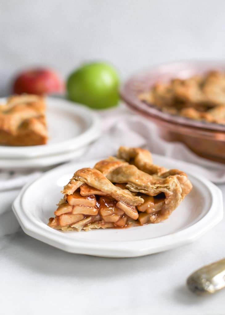 piece of apple pie on white dessert plate