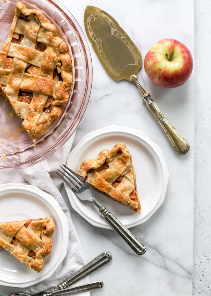 pieces of apple pie on marble board