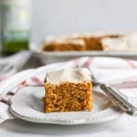 Pumpkin Cake with chai frosting on dessert plate with fork