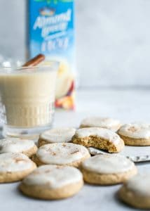 frosted eggnog cookies with glass of almond nog
