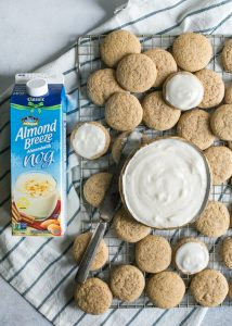 almond nog eggnog sugar cookies with frosting in bowl