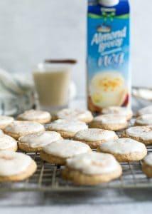 eggnog cookies on rack with Almond Breeze Almondmilk Nog
