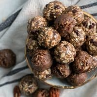 pecan butter energy bites in gold rimmed bowl