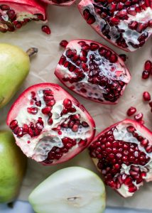 cut open fresh pomegranates with pears