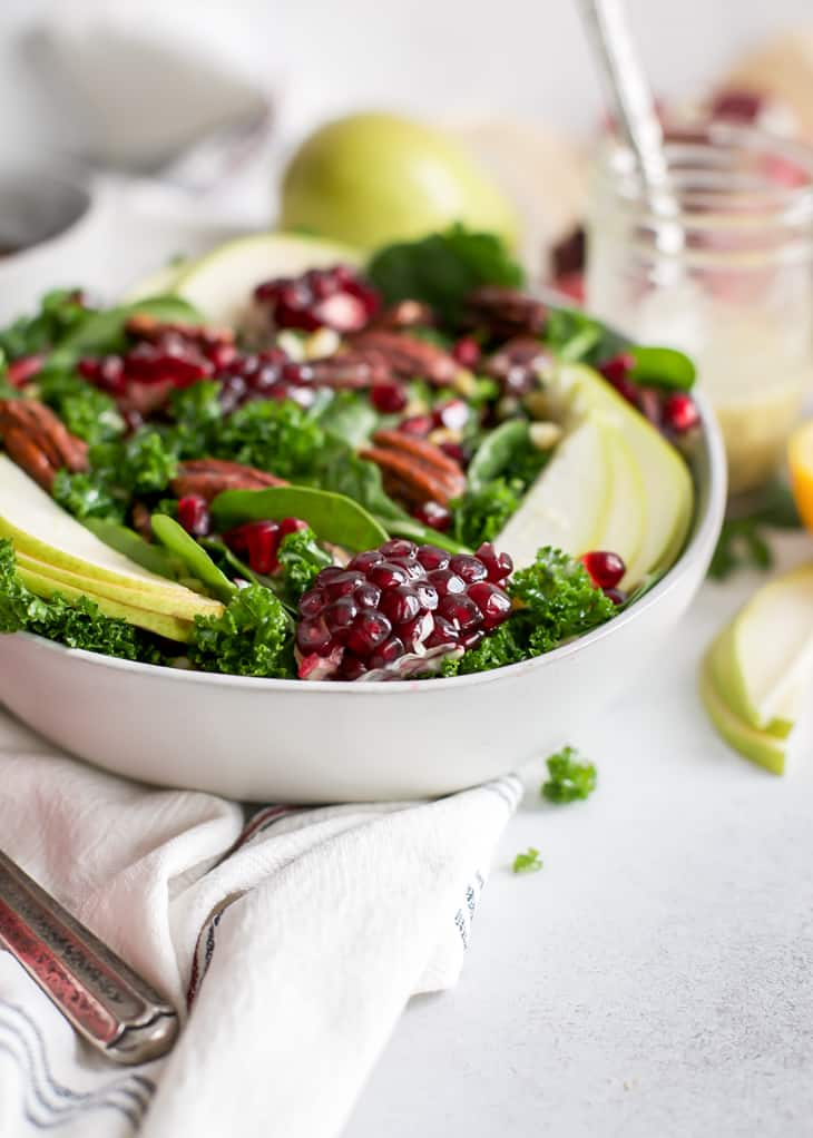 up close angle of pomegranates in pear salad