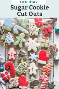 decorated holiday cookies on cooling rack with ornaments