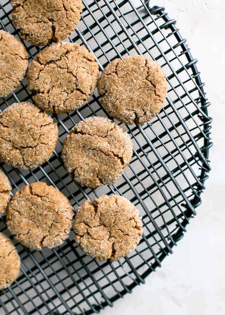 cooling molasses cookies on black trivet