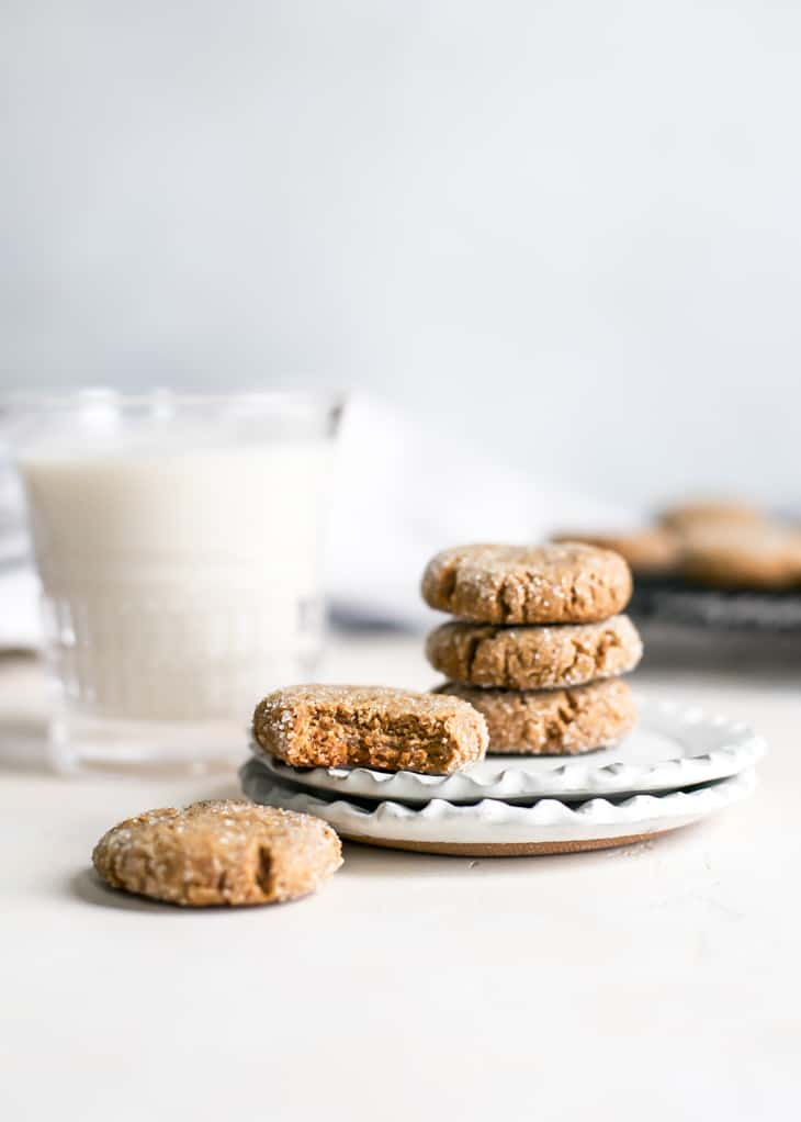 grain free molases cookies on small plate with glass of milk