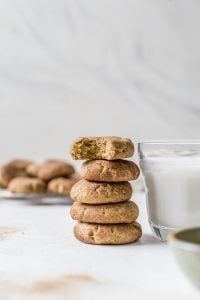 stack of snickerdoodle cookies next to glass of milk