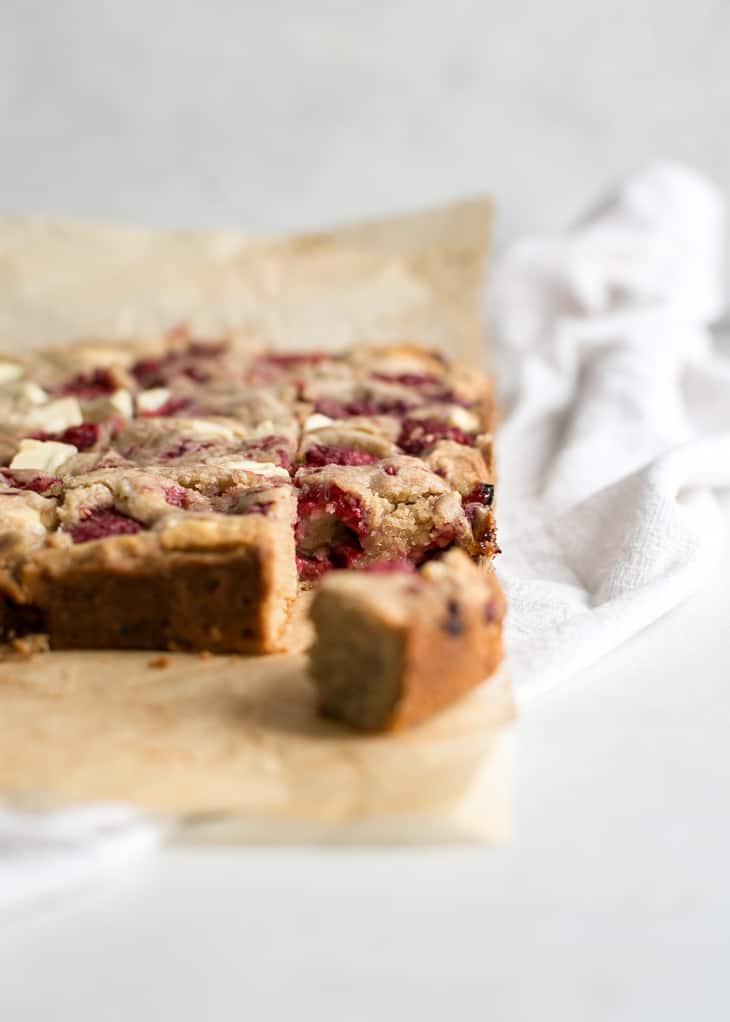 cut white chocolate blondies on parchment paper