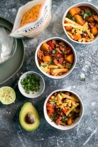 turkey chili in bowls with toppings