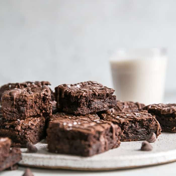 plate of fudgy grain free cassava flour brownies and glass of milk