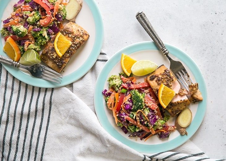 salmon dinner with asian quinoa salad on turquoise rimmed plates