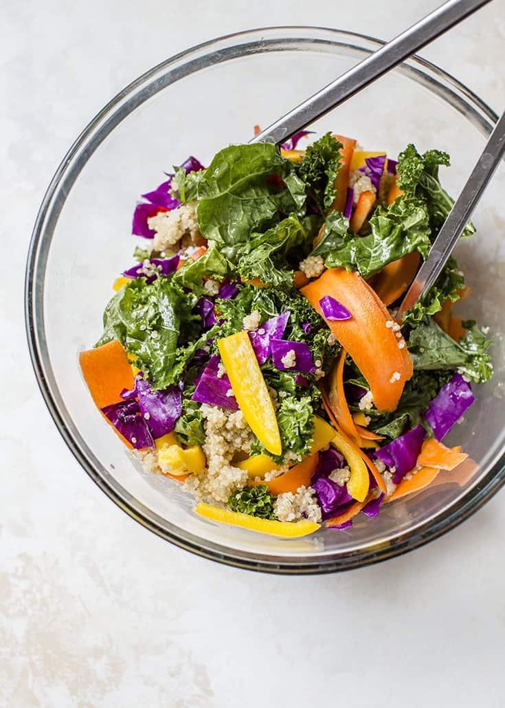 kale, quinoa veggies in bowl for rainbow salad