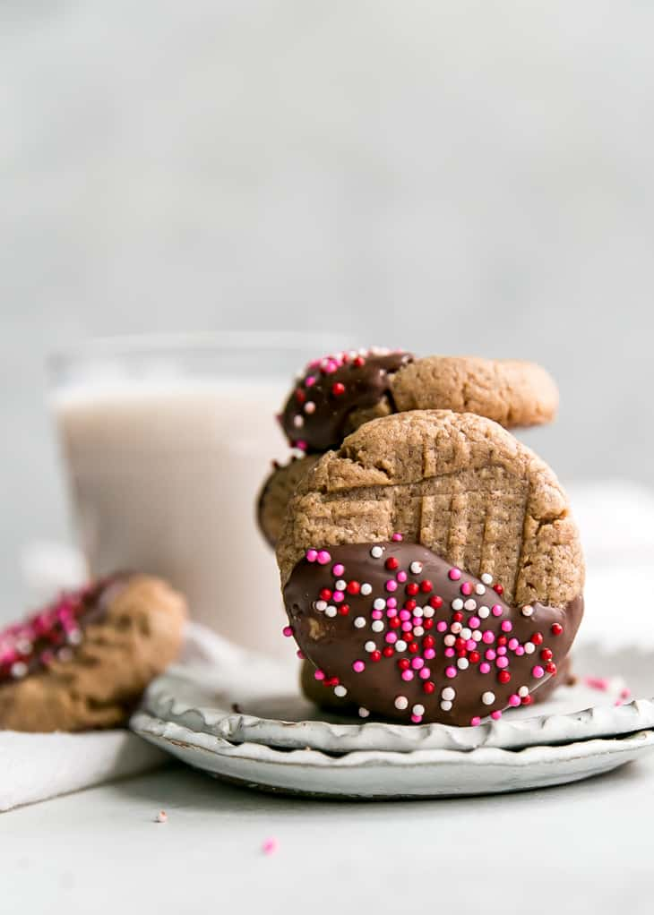 cashew butter cookies dipped in chocolate with sprinkles