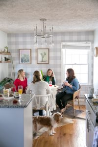 galentine's day gathering with cupcakes in the kitchen corner