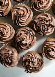 paleo chocolate frosting on cookie dough cupcakes
