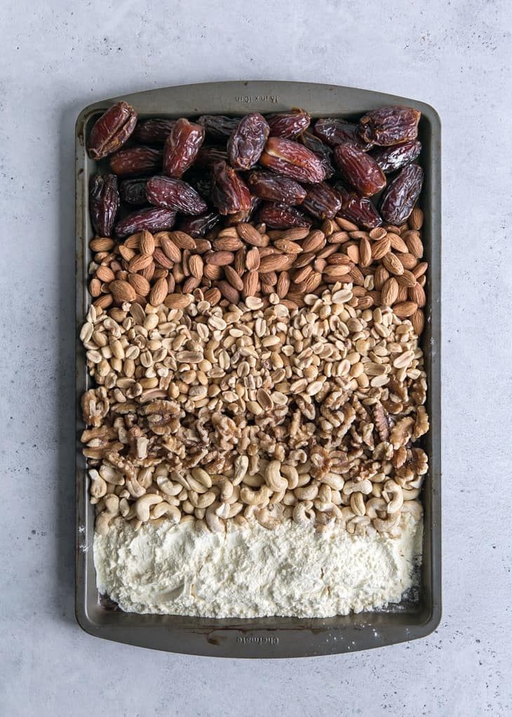 medjool dates, nuts and egg white protein powder on pan for homemade protein bars