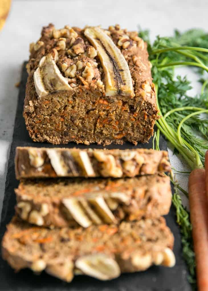 sliced carrot cake banana bread loaf on slate board