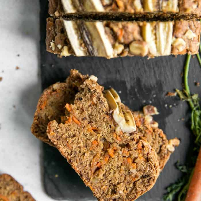 pieces of carrot cake banana bread loaf on slate board