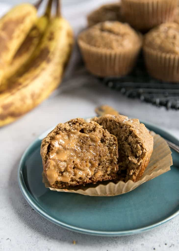healthy banana muffins on teal plate with peanut butter