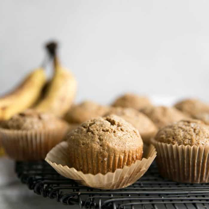 healthy banana muffins on cooling rack with paper