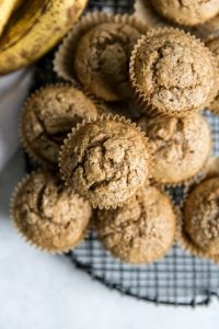 whole wheat banana muffins on cooling rack